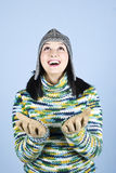 Happy winter girl looking up. And standing with hands open to receive something.You can add in photo snowflakes,gifts  etc.,check also my photos in this Royalty Free Stock Photography