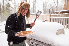 Happy winter griller Royalty Free Stock Images