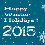 Happy winter holidays. Abstract colorful background with the text Happy Winter Holidays 2015 written in white over a blue background with white snowflakes Stock Photography
