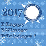 Happy winter holidays. Blue background with white snowflakes and the text Happy Winter Holidays written in dark blue Royalty Free Stock Photo