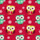 Happy winter holidays!  Seamless pattern with owls. Vector backg. Merry Christmas and Happy New Year! Cute seamless pattern with owls, gifts and snowflakes Stock Photo