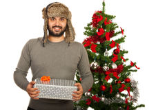 Happy winter man with gift Royalty Free Stock Image