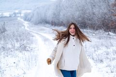 Happy winter. Playing with snow and having fun in winter park. Activity smiling girl in winter travel. Having fun in stock photos