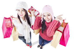 Happy winter shopping with friends - isolated Royalty Free Stock Photo