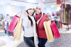 Happy winter shopping in mall Stock Image