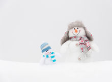 Happy winter snowmen family or friends Stock Images