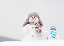 Happy winter snowmen family or friends Stock Photo
