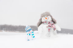 Happy winter snowmen family or friends Royalty Free Stock Photos