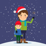 Happy winter time. Mom and son with fireworks Royalty Free Stock Photo