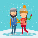 Happy winter time. Young couple skates Stock Images