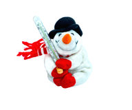Happy winter toy christmas snowman with carrot in black hat and red mittens. Smiling Snowman toy wearing a scarf and a black hat with a thermometer and pills Royalty Free Stock Photo