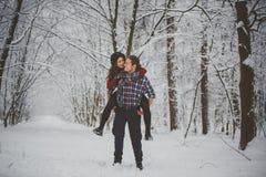 Happy winter travel couple stock images
