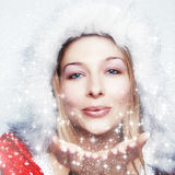 Happy Winter Woman Blowing Snowflakes Royalty Free Stock Photography