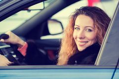 Happy winter woman, buckled up driving testing her new car Stock Images