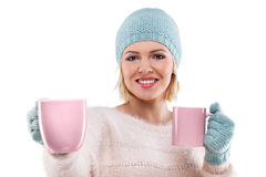 Happy winter woman holding a cup of tea Stock Images