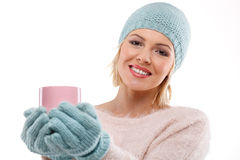 Happy winter woman holding a cup of tea Stock Photography
