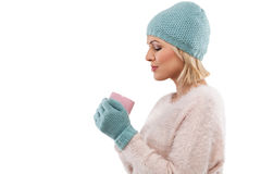 Happy winter woman holding a cup of tea Royalty Free Stock Photography