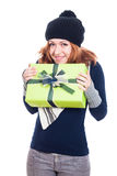 Happy winter woman with present Royalty Free Stock Photos
