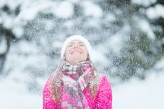 Happy winter women in park snow Christmas lights. Happy winter woman in park snow and Christmas lights Royalty Free Stock Photo