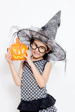 Happy witch child with pumpkin Stock Image