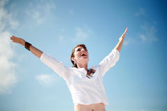 Happy Woman. A beautiful woman smiling with arms open Royalty Free Stock Image
