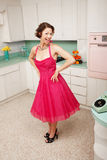 Happy Woman. Happy middle-aged woman with hands on hips in retro-styled kitchen scene Stock Photography