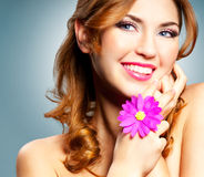 Happy woman. Beautiful happy smiling woman with long curly hair Stock Photos