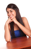 Happy woman. Young woman sitting at a desk looking sideways Royalty Free Stock Photos