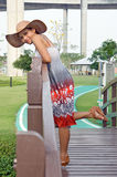 Happy woman. Woman in dress on footbridge in Lad Poe Garden Health Stock Photo