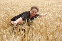 Happy woman. On the wheat field royalty free stock photography