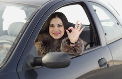 Happy woman. In the car Royalty Free Stock Photos