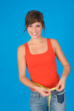 A happy woman. With a metering band Stock Image