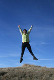Happy woman. Jumping on a blue sky Stock Image