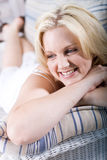 Happy woman. Beautiful happy blond woman relaxing at home on the sofa Stock Photos