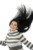 Happy woman. Beautiful happy  brunette woman with a big smile running or dancing  and flipping her hair expressing happiness.Check also Eyes,hair and human face Stock Photography