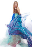 Happy woman. In colorful dress dancing isolated on white Royalty Free Stock Photos