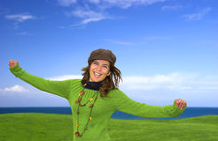 Happy woman. In a green lansdscape with a great blue sky Royalty Free Stock Images