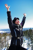 Happy woman. Standing against snowy mountains and blue sky Stock Images