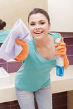Happy woman acting like cleaning Royalty Free Stock Images