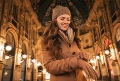 Happy woman adjusting glove in Galleria Vittorio Emanuele II Stock Images