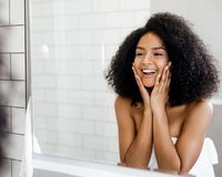Happy woman admiring her skin Stock Photography