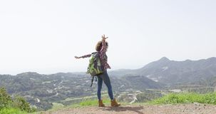 Happy woman against mountains stock video footage
