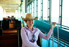 Happy woman in airport Royalty Free Stock Image