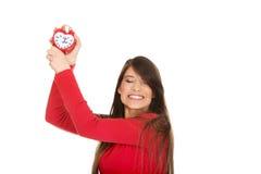 Happy woman with alarm clock. Stock Photos