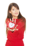 Happy woman with alarm clock. Royalty Free Stock Photos
