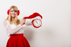 Happy woman with alarm clock. Christmas time. Royalty Free Stock Photos