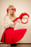 Happy woman with alarm clock. Christmas time. Stock Photos