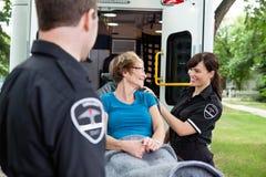 Happy Woman on Ambulance. Senior citizen women on an ambulance stretcher Stock Photo