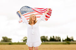 Happy woman with american flag on cereal field Royalty Free Stock Image