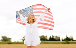 Happy woman with american flag on cereal field Royalty Free Stock Photography